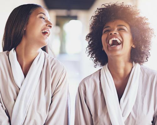 women laughing with white veneers