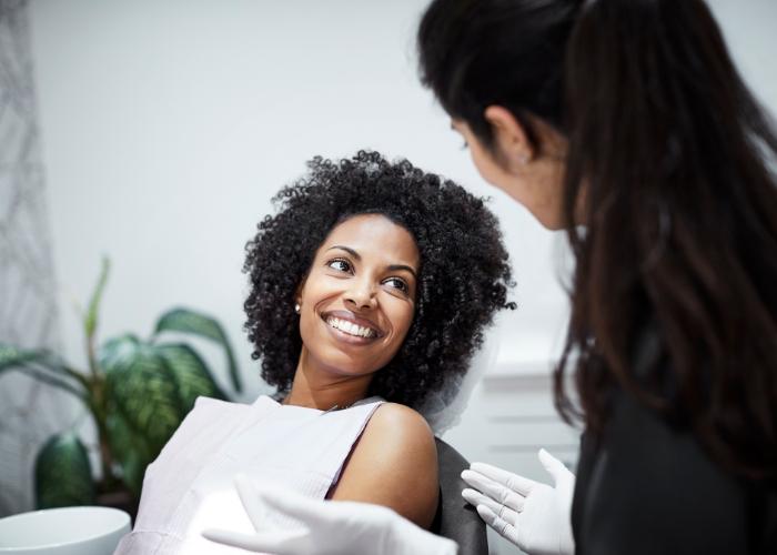Woman having in a dentist chair having a consultation